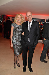 JERRY HALL and writer ARMAND LEROI at the Costa Book Awards 2013 held at Quaglino's, 16 Bury Street, London on 28th January 2014.