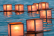 Lanterns lit with candles float at Ala Moana Beach Park in remembrance of those who have passed.