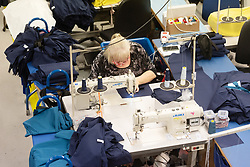 © Licensed to London News Pictures. 17/04/2020. London, UK. A machinist sews medical clothing for the NHS (National Health Service) at Fashion-Enter Ltd's factory. The British government continues to try to combat the COVID-19 outbreak, with many garment manufacturers across the country turning to produce medical equipments for the NHS. Photo credit: Ray Tang/LNP