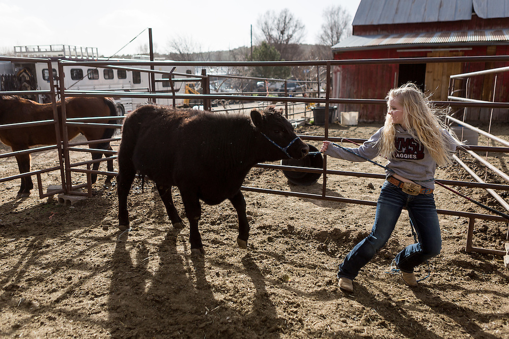 """CREDIT: Steven St. John for The Wall Street Journal<br /> """"ANIMAS<br /> <br /> Brian Dils 15-year-old daughter Brilie tends to the animals on the family land in Aztec New Mexico on Tuesday March 23, 2016."""