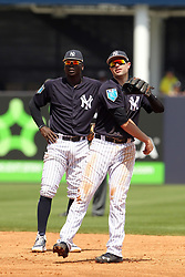 March 18, 2018 - Tampa, FL, U.S. - TAMPA, FL - MAR 18: Didi Gregorius (18) of the Yankees watches Neil Walker (14) throw the ball over to first base during the game between the Miami Marlins and the New York Yankees on March 18, 2018, at George M. Steinbrenner Field in Tampa, FL. (Photo by Cliff Welch/Icon Sportswire) (Credit Image: © Cliff Welch/Icon SMI via ZUMA Press)