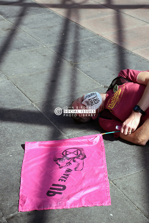 """Extinction Rebellion Norwich clean air """"die-in"""" at Anglia Square to highlight high levels of pollution in parts of the city and promote Car Free Day. Anglia Square is at the centre of a controversial development debate. Norwich UK 14 September 2019"""
