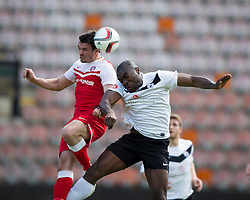 Brora Rangers Steven McKay and Edinburgh City's Joseph Mbu.<br /> half time : Edinburgh City 0 v 0 Brora Rangers, 1st leg, Pyramid Playoffs at Meadowbank, 25/4/2015.
