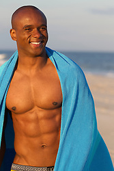 handsome African American man enjoying time at the beach in The Hamptons