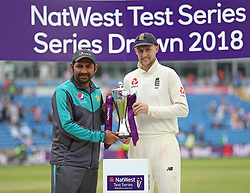 England's captain Joe Root (right) alongside Pakistan's captain Sarfraz Ahmed after the drawn NatWest Test series during day three of the Second NatWest Test match at Headingley, Leeds.