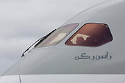 "The cockpit window and nose design of a Qatar Airways Boeing 787 at the Farnborough Air Show, UK. Having just taken delivery of their new generation ''Deamliner"" three years late, the middle-east based airline is displaying on the ground. The Boeing 787 Dreamliner is a long-range, mid-size wide-body, twin-engine jet airliner developed by Boeing Commercial Airplanes. It seats 210 to 290 passengers, depending on the variant. Boeing states that it is the company's most fuel-efficient airliner and the world's first major airliner to use composite materials for most of its construction. According to Boeing, the 787 consumes 20% less fuel than the similarly-sized 767."