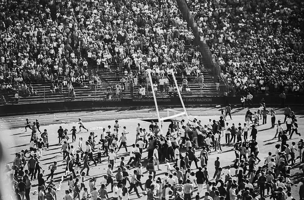 COLLEGE FOOTBALL:  Stanford vs USC (#4 ranking) on October 10, 1970 at Stanford Stadium in Palo Alto, California.  Stanford won by a final score of 24-14.  Fans tear down goal posts following game.  Stanford's Charles McCloud #21 and Jim Kauffman #23 visible at right.  Photograph by David Madison / www.davidmadison.com.  R0067