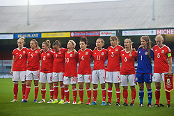 CARDIFF, WALES - Friday, August 19, 2016: Wales players sing the national anthem ahead of the international friendly match against Republic of Ireland at Rodney Parade. Rhiannon Roberts, Kayleigh Green, Rachel Rowe, Natasha Harding, Jessica Fishlock, Angharad James, Melissa Fletcher, Gemma Evans, Kylie Davies, goalkeeper Claire Skinner, captain Sophie Ingle. (Pic by Laura Malkin/Propaganda)