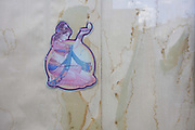 Detail of a girl dancer and stains from a damp window outside a closed Indian restaurant and take-away. Seen in close-up, the dancing girl appears to be holding a diva lamp, wearing a sari and other traditional Indian clothing and adornment. She is surrounded by the stained curtains that cover the inside of this shut restaurant. It may have closed due to recession or perhaps relocating to another address although it appears the poorly maintained nature of this property means it wasn't a healthy business.