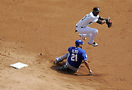 CHICAGO - AUGUST 19:  Alexei Ramirez #10 of the Chicago White Sox turns a double play over a sliding Miguel Olivo #21 of the Kansas City Royals on August 19, 2009 at U.S. Cellular Field in Chicago, Illinois.  The White Sox defeated the Royals 4-2.  (Photo by Ron Vesely)