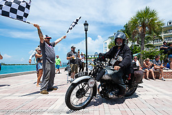 Paul Warrenfelt riding his 1935 Triumph 250cc Single across the finish line of the Cross Country Chase motorcycle endurance run from Sault Sainte Marie, MI to Key West, FL. (for vintage bikes from 1930-1948). The Grand Finish in Key West's Mallory Square after the 110 mile Stage-10 ride from Miami to Key West, FL and after covering 2,368 miles of the Cross Country Chase. Sunday, September 15, 2019. Photography ©2019 Michael Lichter.