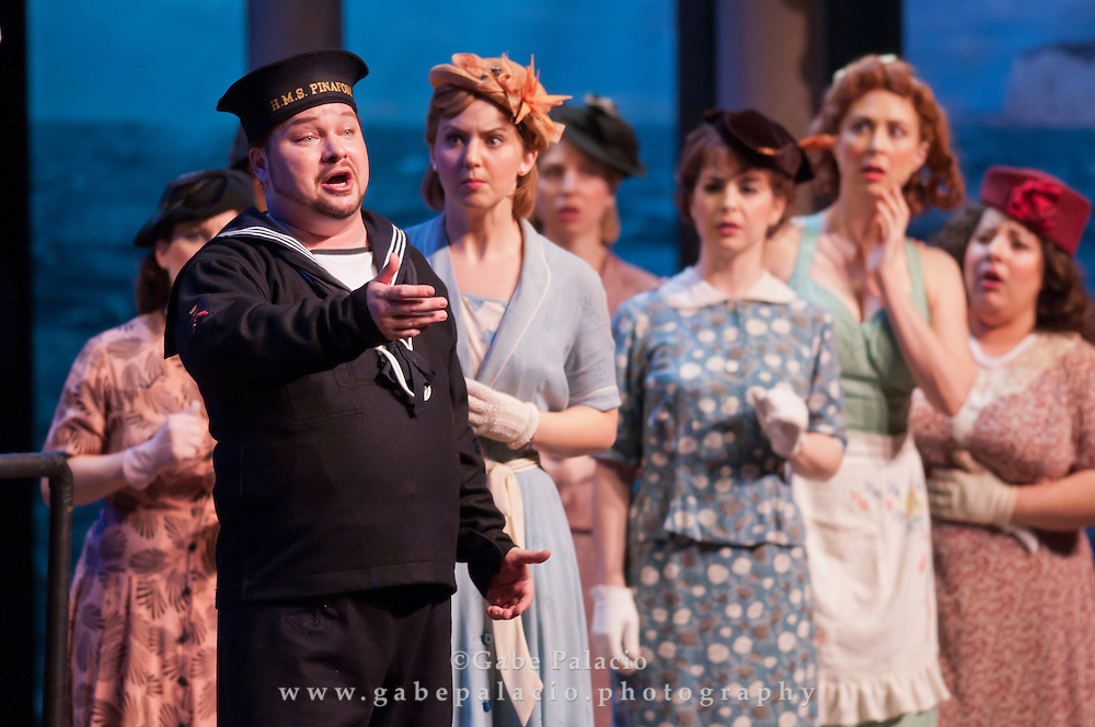 Robert McPherson, tenor, in the role of Ralph Rackstraw, with the Caramoor Festival Chorus during the performance of HMS Pinafore, a Bel Canto at Caramoor performance in the Venetian Theater of Caramoor in Katonah New York..photo by Gabe Palacio
