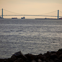 The Verrazano-Narrows Bridge is a double-decked suspension bridge that connects the boroughs of Staten Island and Brooklyn on Long Island in New York City at the Narrows, the reach connecting the relatively protected upper bay with the larger lower bay.The bridge is named for Italian explorer Giovanni da Verrazzano, the first known European navigator to enter New York Harbor and the Hudson River, while crossing The Narrows. It has a center span of 4,260 feet (1,298 m) and was the largest suspension bridge in the world at the time of its completion in 1964, until it was surpassed by the Humber Bridge in the United Kingdom in 1981. It now has the eighth longest center span in the world, and is the largest suspension bridge in the United States. Its massive towers can be seen throughout a good part of the New York metropolitan area, including from spots in all five boroughs of New York City. The bridge furnishes a critical link in the local and regional highway system. It is the starting point of the New York City Marathon. The bridge marks the gateway to New York Harbor; all cruise ships and most container ships arriving at the Port of New York and New Jersey must pass underneath the bridge and thus must be built to accommodate the clearance under the bridge.
