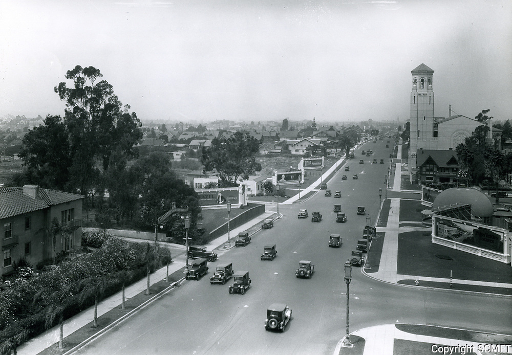 1928 Looking west on Wilshire Blvd at Alexandria St.