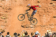 """Mountain biking competition in Virgin, Utah. Photo of a rider above the crowd doing a """"no hander"""" while in the air."""