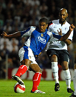 Photo: Ed Godden.<br /> Portsmouth v Bolton Wanderers. The Barclays Premiership. 25/09/2006. Portsmouth's Glen Johnson (L) is tackled by Nicolas Anelka.