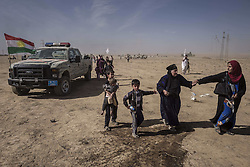 October 21, 2016 - Nineveh Governorate, Iraq - Civilians escape from Khorsabad which is controlled by ISIS and under Peshmerga fire. (Credit Image: © Bertalan Feher via ZUMA Wire)