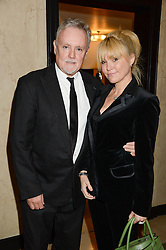 """Musician ROGER TAYLOR and his wife SERENA at an """"Evening With Damon Hill'  a dinner and talk in aid of the Downs Syndrome Association held at Claridge's, Brook Street, London on 7th November 2013."""