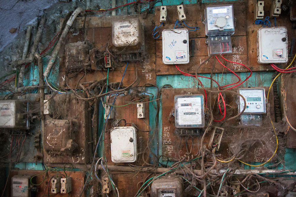 The faulty electrical wiring lines one of the entryways to a government constructed building in a slum in Chennai, India.