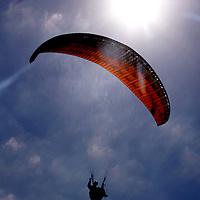 USA, California, San Diego. Paraglider, Clouds and Sun.