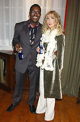 Top florist ORLANDO HAMILTON and BASIA BRIGGS at a party to launch a new stor for tailors Pogson & Davis in Davies Street, London W1 on 15th December 2005.<br />