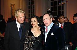 A party hosted by Mario Testino, Bianca Jagger and Kenneth Cole in collaboration with UNFPA and Marie Stopes International to celebrate the publication of Women to Woman: Positively Speaking - a book to raise awareness of women living with HIV/Aids, held at The Orangery, Kensington Palace, London on 2nd December 2004.<br />Picture shows:- Left to right, MARIO TESTINO, BIANCA JAGGER and Fashion designer MR TOMMY HILFIGER.<br /><br /><br />NON EXCLUSIVE - WORLD RIGHTS