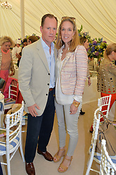 LORD & LADY WROTTESLEY at the Cartier hosted Style et Lux at The Goodwood Festival of Speed at Goodwood House, West Sussex on 29th June 2014.