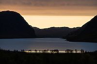 dawn silhouette of mountain landscape and lake Kaitumjaure, Kungsleden trail, Lapland, Sweden