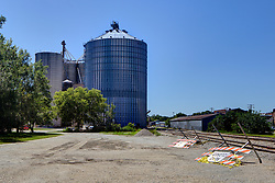 31 July 2015:  Colfax Illinois.   A grain elevator in a midwest town is needed for trade and to keep the agricultural breadbasket of the world functioning.  They also double as landmarks and help to give small communities identities.  They are often thought of as midwestern skyscrapers as they can define a skyline and are often taller than even a towns water tower.<br /> <br /> <br /> This image was produced in part utilizing High Dynamic Range (HDR) processes.  It should not be used editorially without being listed as an illustration or with a disclaimer.  It may or may not be an accurate representation of the scene as originally photographed and the finished image is the creation of the photographer.