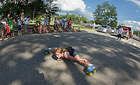 kCassidy Dion of the Skate Escape crew does a split for the crowd gathered outside Opechee Park for the annual 4th of July parade Thursday afternoon.  (Karen Bobotas/for the Laconia Daily Sun)