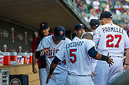 Eduardo Escobar #5 and Trevor Plouffe #24 of the Minnesota Twins get ready before a game against the Kansas City Royals on June 27, 2013 at Target Field in Minneapolis, Minnesota.  The Twins defeated the Royals 3 to 1.  Photo by Ben Krause