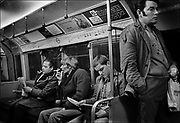 Smoking carriage, piccadily line underground.<br /> Smoking was allowed in certain carriages in trains until 9 July 1984. In the middle of 1987 smoking was banned for a six-month trial period in all parts of the Underground, and the ban was made permanent after the major King's Cross fire in November 1987. Coming and Going is a project commissioned by the Museum of London for photographer Barry Lewis in 1976 to document the transport system as it is used by passengers and commuters using public transport by trains, tubes and buses in London, UK.