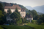A former fortified house-turned hotel and vineyard in the Dolomites region south-west of Bolzano, South Tyrol. South Tyroleans are almost all Catholics and quite conservative - though it depends on the areas. In South Tyrol there are three indigenous wine varieties: Schiava, Gewürztraminer and Lagrein. The Überetsch (Oltradige in Italian) is a hilly section of the Etschtal in South Tyrol, northern Italy. It lies south-west of Bolzano and is a known tourist destination, famous for its wines, castles and lakes (Kalterer See, Montiggler Seen). The municipalities of the Überetsch are Kaltern and Eppan.