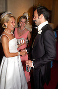 The Duchess of Marlborough,  the hon Hillary Weston and Tom Ford, Ball at Blenheim Palace in aid of the Red Cross, Woodstock, 26 June 2004. SUPPLIED FOR ONE-TIME USE ONLY-DO NOT ARCHIVE. © Copyright Photograph by Dafydd Jones 66 Stockwell Park Rd. London SW9 0DA Tel 020 7733 0108 www.dafjones.com