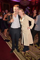 "MARK HIX and MARISSA HERMER at the presentation of Le Prix Champagne De La Joie de Vivre to Stephen Webster in celebration of his long standing contribution to ""Joie de Vivre' held at the Council Room, One Great George Street, London on 22nd April 2015."