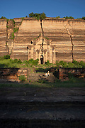The vast Mingun Pahtodawgyi pagoda was never completed, and now stands overgrown and cracked. Mingun, near Mandalay, Myanmar