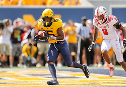 Sep 14, 2019; Morgantown, WV, USA; West Virginia Mountaineers wide receiver George Campbell (15) catches a touchdown pass during the second quarter against the North Carolina State Wolfpack at Mountaineer Field at Milan Puskar Stadium. Mandatory Credit: Ben Queen-USA TODAY Sports