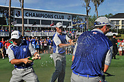 From left, Graeme McDowell of Lake Nona celebrates with teammates, Ross Fisher and Gary Woodland after their team won the 2012 Tavistock Cup at Lake Nona Golf and Country Club in Orlando, Florida March 20, 2012.