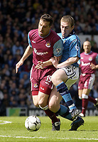 Manchester City v West Ham United, FA Barclaycard Premiership, Maine Road, Manchester. 27/04/2003.<br />Man City's Richard Dunne (R) clatters into West Ham's Ian Pearce.<br />Photo. Jed Wee, DIGITALSPORT