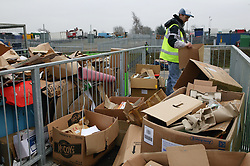 Man working at the Tipsmart recycling centre at Calverton,