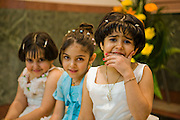 Young girls who are wedding guests sit in the Talar Yazd Restaurant in the city of Yazd, Iran.