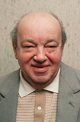 Portrait of elderly man wearing suit jacket,