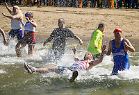 """Team """"Live, Freeze or Die"""" from the Merrimack Police Dept made a splash during the 8th annual WInni Dip for Special Olympics at the Margate Beach on Saturday.   (Karen Bobotas/for the Laconia Daily Sun)"""