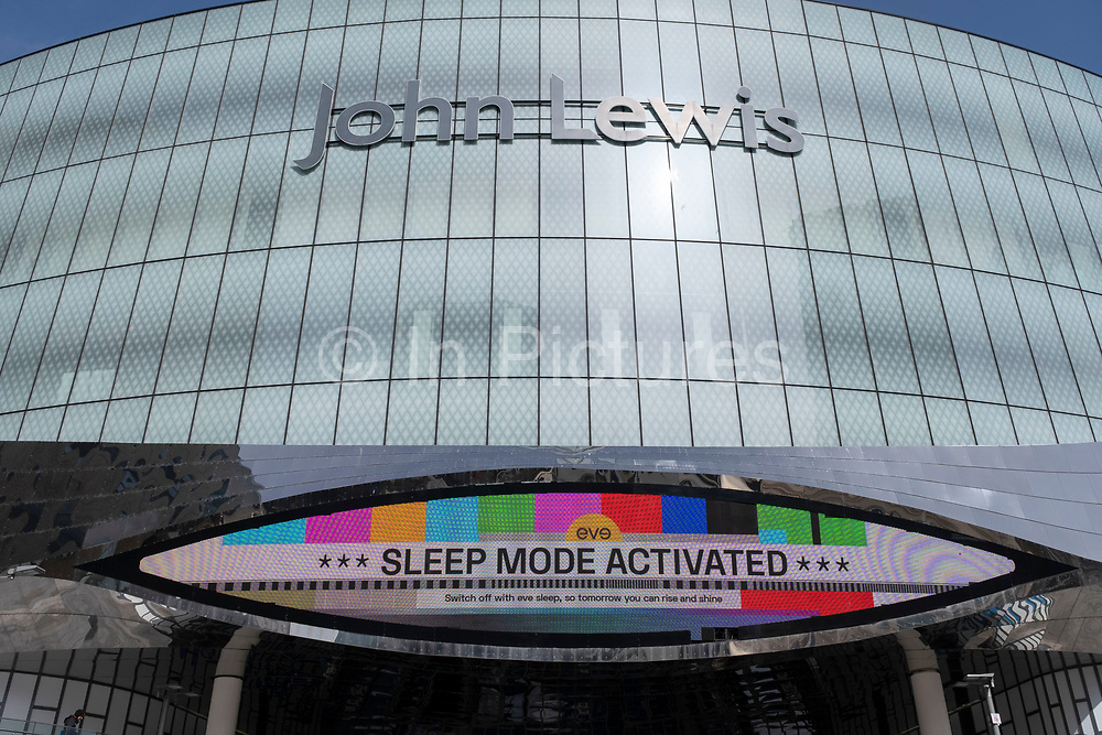 Sleep activated sign and exterior of the closed John Lewis store on 30th March 2021 in Birmingham, United Kingdom. John Lewis, one of the UKs most well known and loved department stores has struggled with its finances through the pandemic, resulting in the loss of many jobs and the closing of some of its stores.