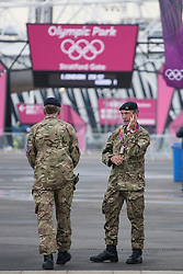 © licensed to London News Pictures. London, UK 20/07/2012. Soldiers guarding Stratford gate of the Olympic site on 20/07/12. Photo credit: Tolga Akmen/LNP