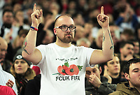 Football - 2016 / 2017 World Cup Qualifier - Group F: England vs. Scotland<br /> <br /> England fan with a message to FIFA over the wearing of a poppy at Wembley.<br /> <br /> COLORSPORT/ANDREW COWIE