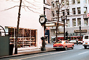 CS02162. Reingold street clock. Reingold's jewelers. 504 SW Fourth. corner of Washington. February 1976