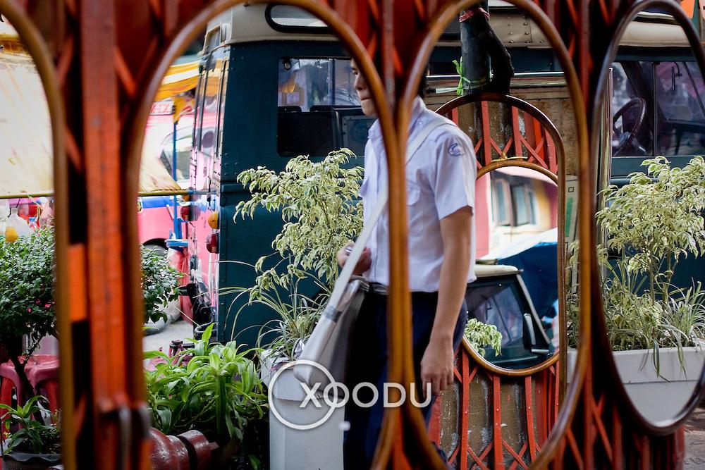 Mirrors reflecting Bangkok street life (Bangkok, Thailand - Oct. 2008) (Image ID: 081019-1611291a)