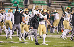 Dec 18, 2020; Huntington, West Virginia, USA; UAB Blazers head coach Bill Clark runs onto the field after defeating the Marshall Thundering Herd at Joan C. Edwards Stadium. Mandatory Credit: Ben Queen-USA TODAY Sports
