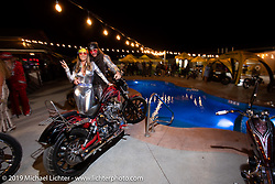 Aaron Greene and Melody Seaton at the Cycle Source Magazine 70's pool party at the Steel Pony Campground during the Sturgis Motorcycle Rally. SD, USA. Thursday, August 12, 2021. Photography ©2021 Michael Lichter.